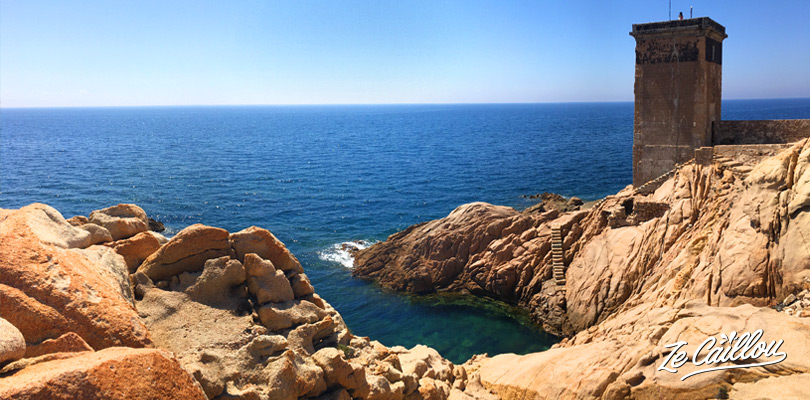 The Capo di Fenu lighthouse and its natural pool in Corsica.