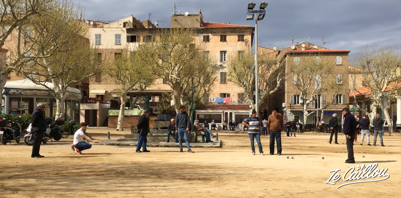 Local people from Corsica playing petanque in a small town.