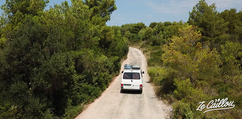 Driving small roads with a campervan on Brac island in Croatia.