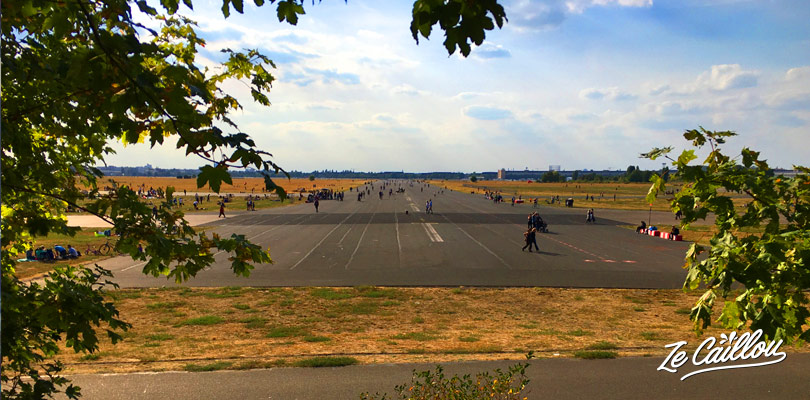 Berlin with a van, parked at Tempelhof park, a former airport with still its landing strips.