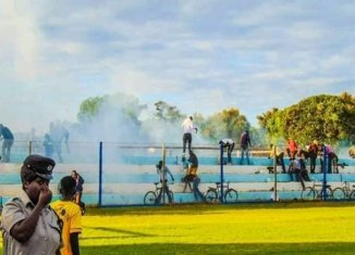 Police fire teargas canister during week 13 of Zambia super league