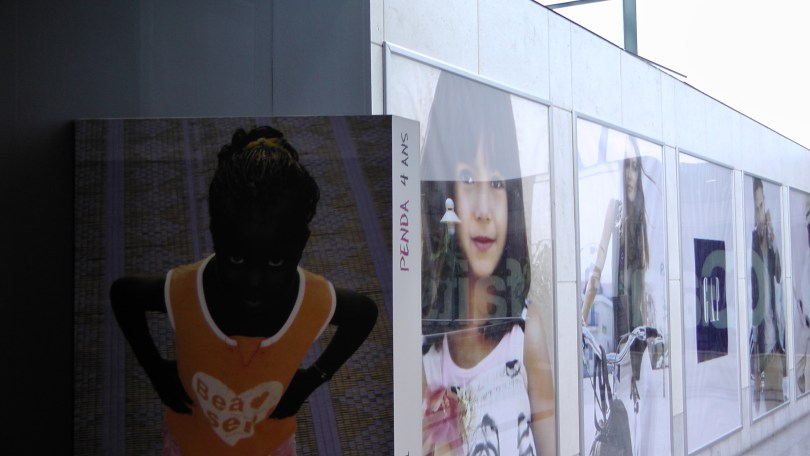 One of the portraits next to an advertisement for The Gap.