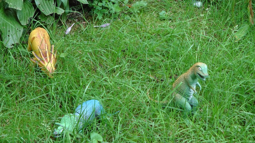 Close up of the dinosaurs on the lawn.