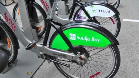 Souljah Boy on the back of a Bixi.