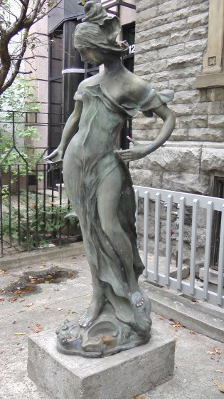 Left view of a statue infront of 1259 Saint Marc.
