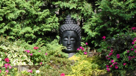 South Asian bust in a garden on Rosemont ave.