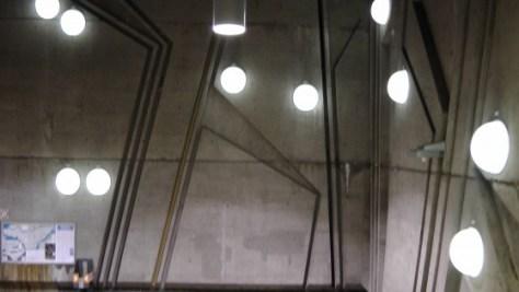 Inside the metro de la Savane (view of the lights and bas relief)