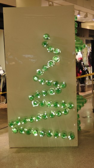 Something that I think is half of the shilouette of a Christmas tree made out of recycled soda bottles.