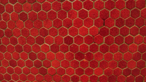 Close up of the tile work on the red/pink wall at Métro Joliette.