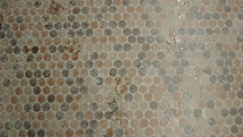 Brown tiles of various hues and tones on the platform at the Métro Joliette.