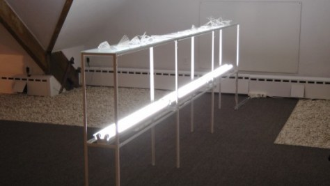 "Elisabeth Picard, Constructions, 2011, zip ties, glass, painted steel, fluorescent tubes, 48"" x 147"" x 10"""