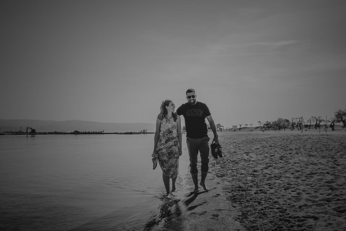 A couple walking on the sandy beach omiš