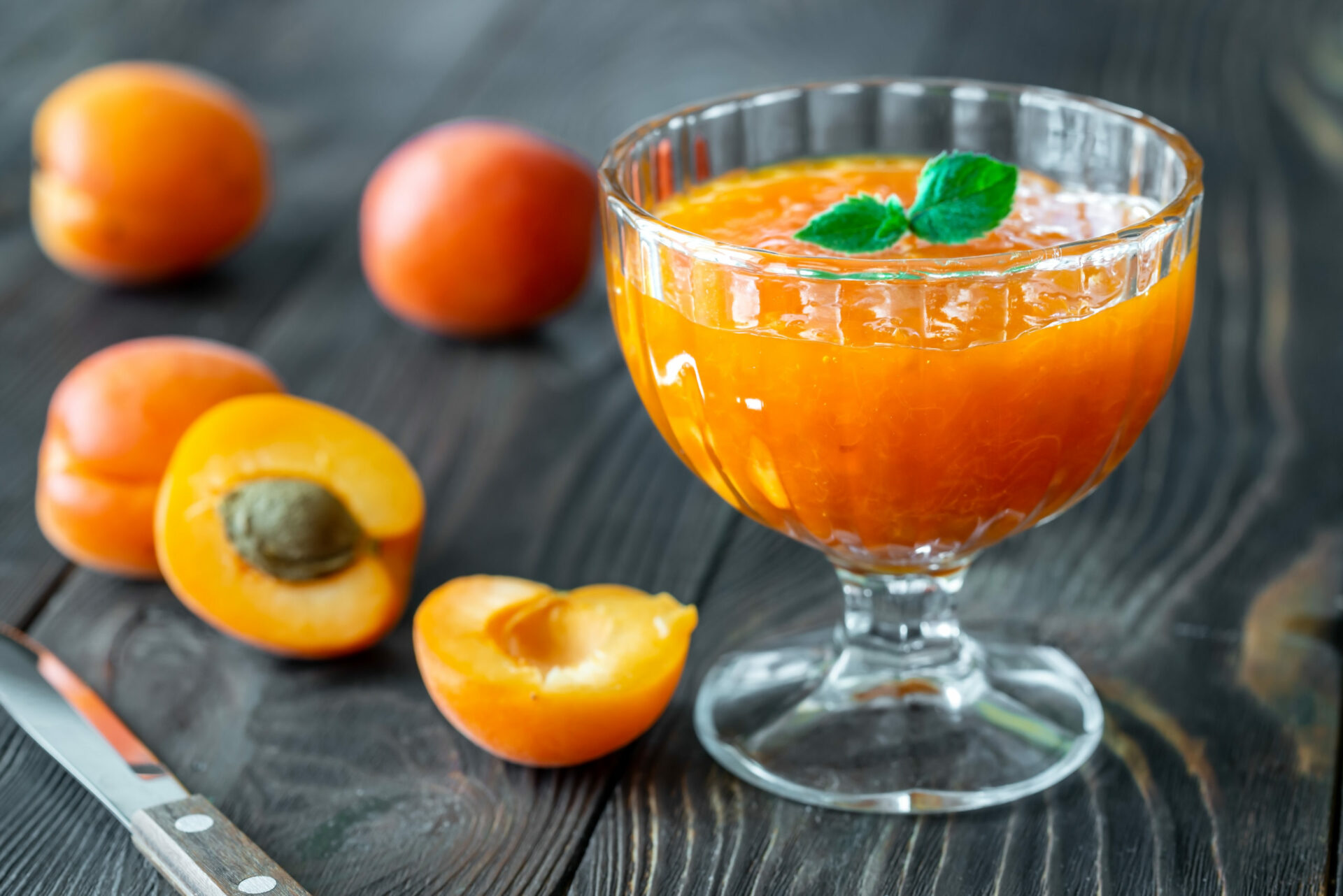 glass vase of apricot jam KLNT2M4 scaled