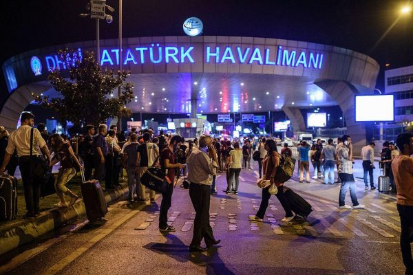 EDITORS NOTE: Graphic content / People stand outside the entrance as they leave the airport after two explosions followed by gunfire hit the Turkey's biggest airport of Ataturk in Istanbul, on June 28, 2016. At least 10 people were killed on June 28, 2016 evening in a suicide attack at the international terminal of Istanbul's Ataturk airport, Turkish Justice Minister Bekir Bozdag said. Turkey has been hit by a string of deadly attacks in the past year, blamed on both Kurdish rebels and the Islamic State jihadist group. / AFP / OZAN KOSE (Photo credit should read OZAN KOSE/AFP/Getty Images)