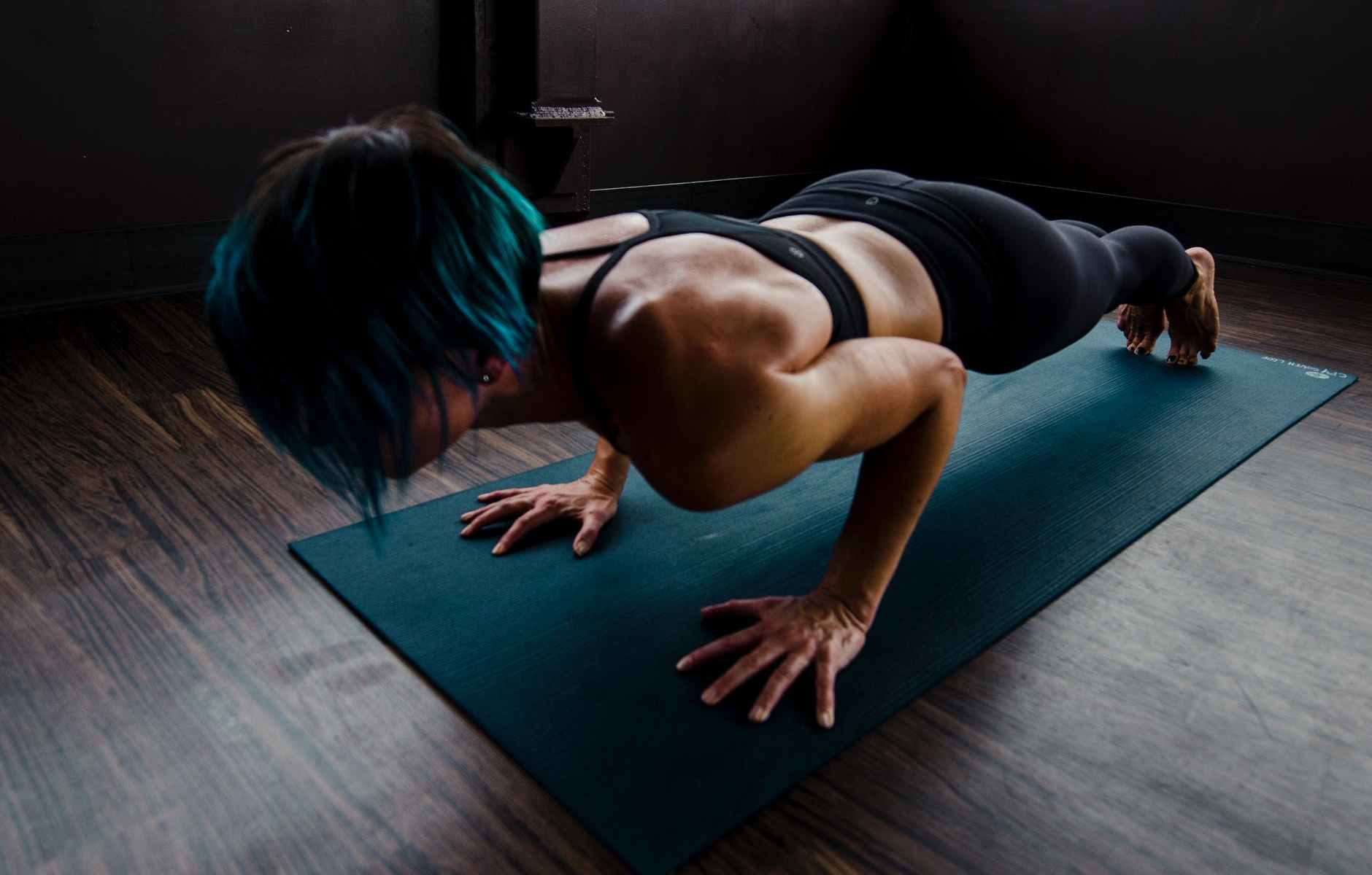 woman doing chaturanga dandasana