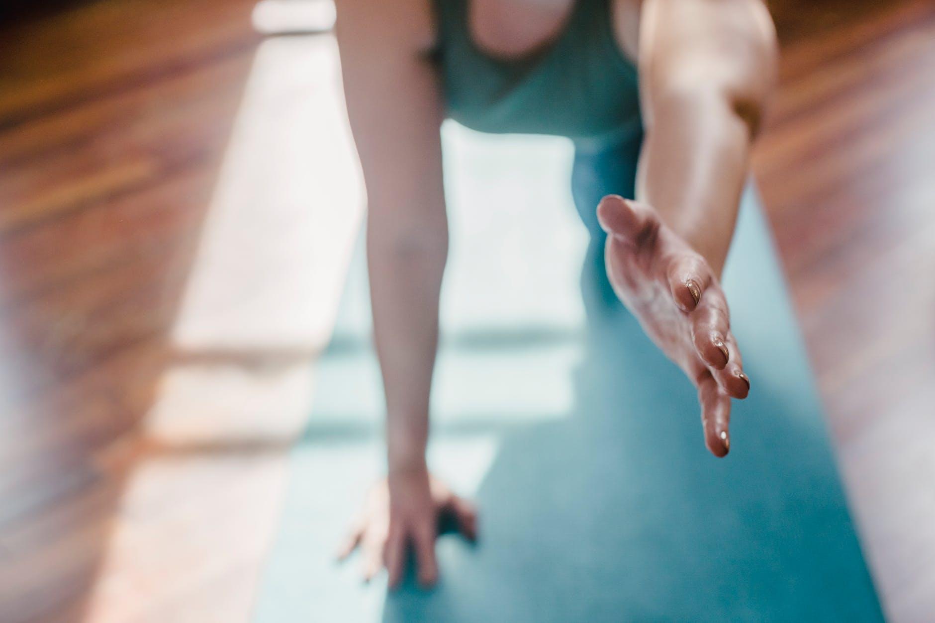 woman in blue tank top doing yoga