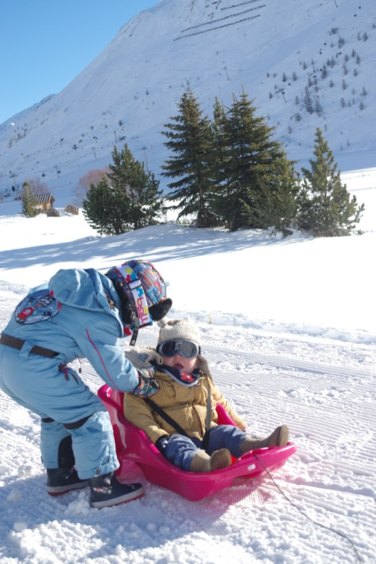 Tignes with baby and kids: sledging on the frozen lake: Espritski holidays