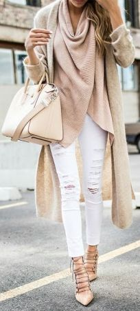 You could layer several thin tops under this cute jumper/cardigan combo.