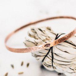 Compassion copper bangle