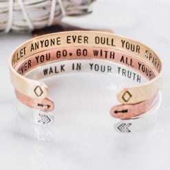 Inspirational cuff set in mixed metals