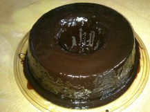 A chocolate cake coated with thick chocolate sauce, baked by the mother unit!