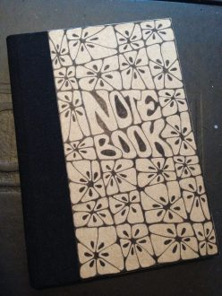 Notebook with squashed flowers