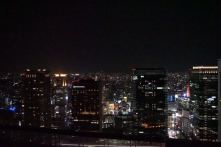 Night view of Osaka from the open observatory deck in Umeda Sky Building