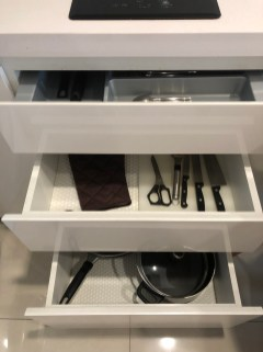 Cutlery in the kitchenette cabinets