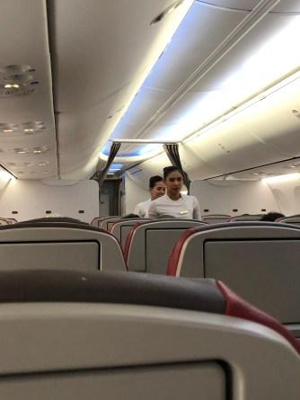 Flight attendants conducting safety brief