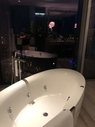 Bathtub overlooking the WET Pool in the Marvellous Suite in W Hotel Sentosa Cove