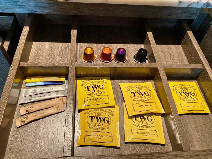 Nespresso capsules and TWG tea bags in minibar