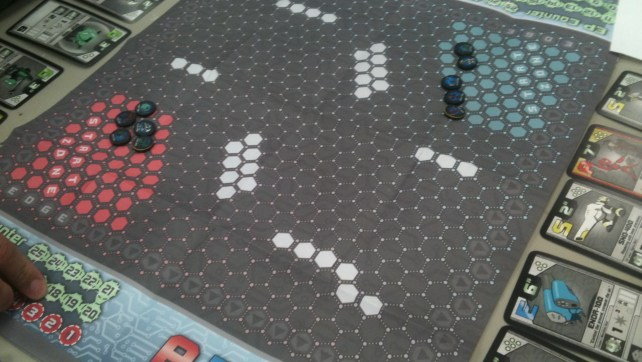 You play on hex grid, five robots vs. five robots!