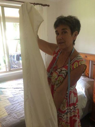 ZEB Story Megan holding curtain