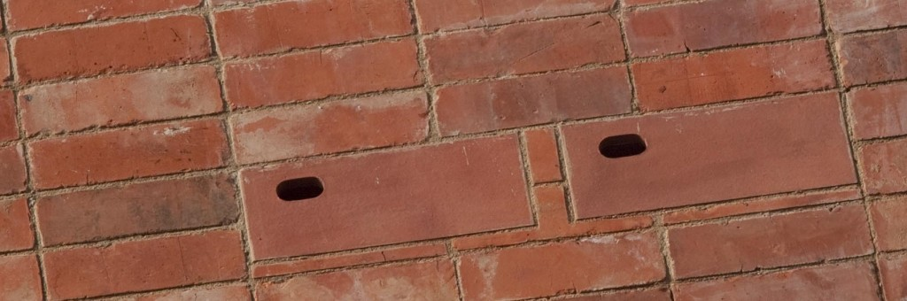 Close up of red brick homes for birds integrated onto the front of zero carbon house, Birmingham