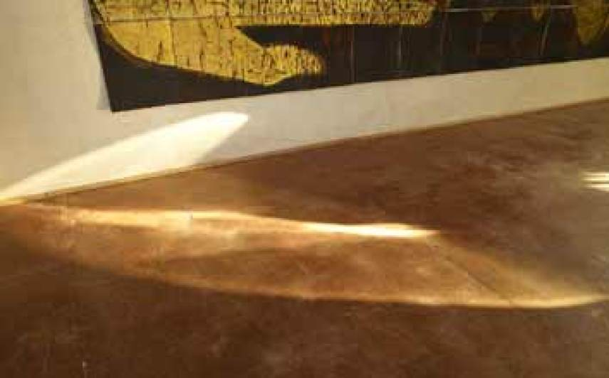 Light falls on the rammed earth floor at zero carbon house Birmingham