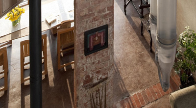 Looking down into zero carbon house, Birmingham from the studio, showing the living room