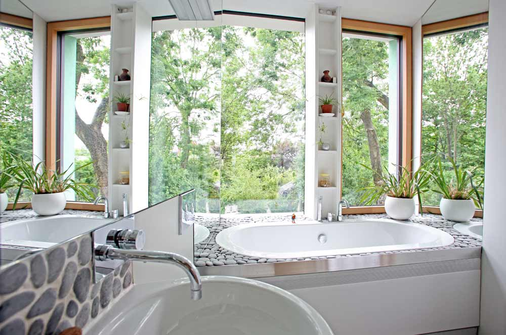 The bathroom in zero carbon house Birmingham showing the garden