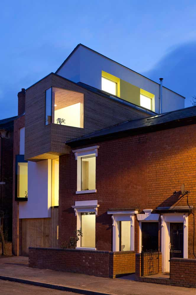 The front of zero carbon house, Birmingham after dark with the lights on
