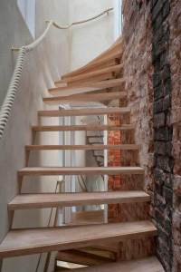 Open stairs at zero carbon house, Birmingham allow light to flood through