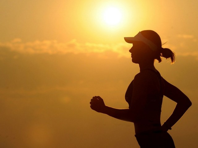 Woman jogging during the sunset