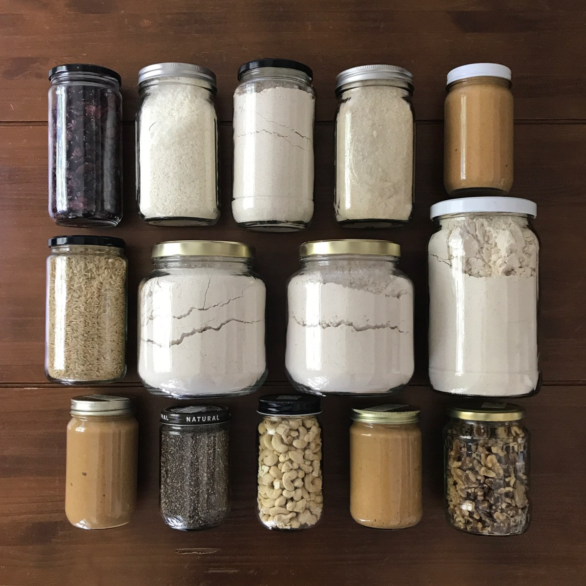jars filled with staples from the bulk bins for zero waste shopping