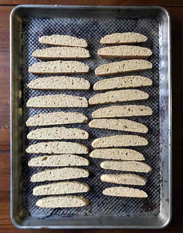 Cook the biscotti dough, allow it to cool, then slice it