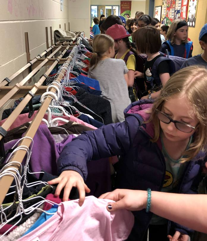 secondhand clothing exchange at an elementary school