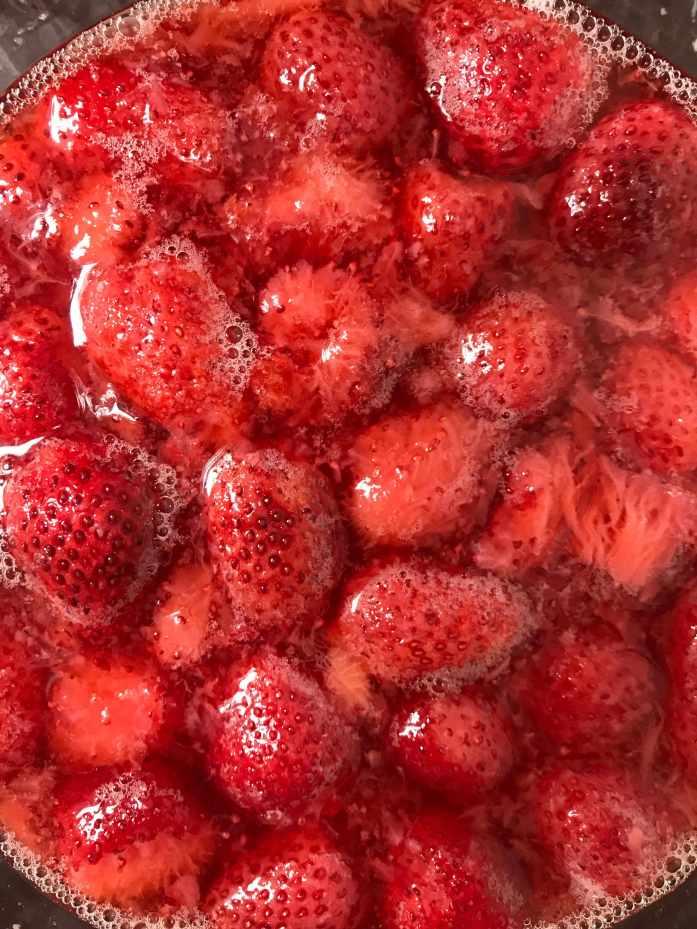 strawberry soda fermenting in a jar