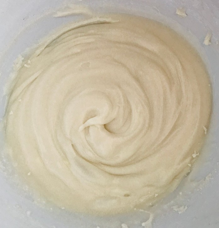 coconut buttercream frosting in a bowl