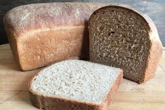 a full loaf and a cut loaf of whole wheat sandwich bread