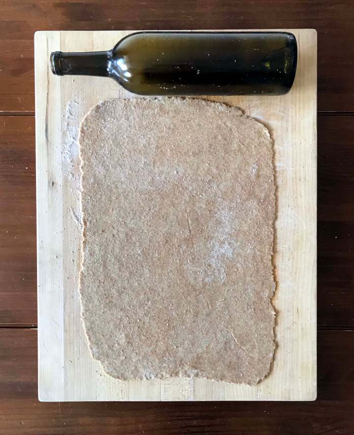 wine bottle used as a rolling pin