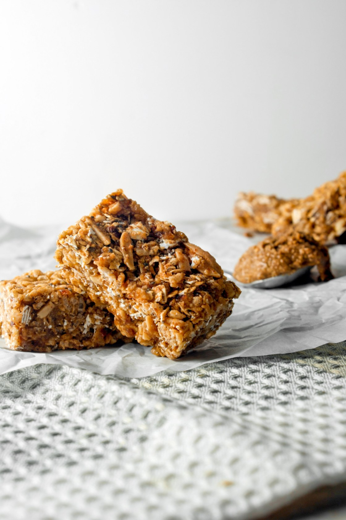 Photograph of almond butter granola bars on white paper