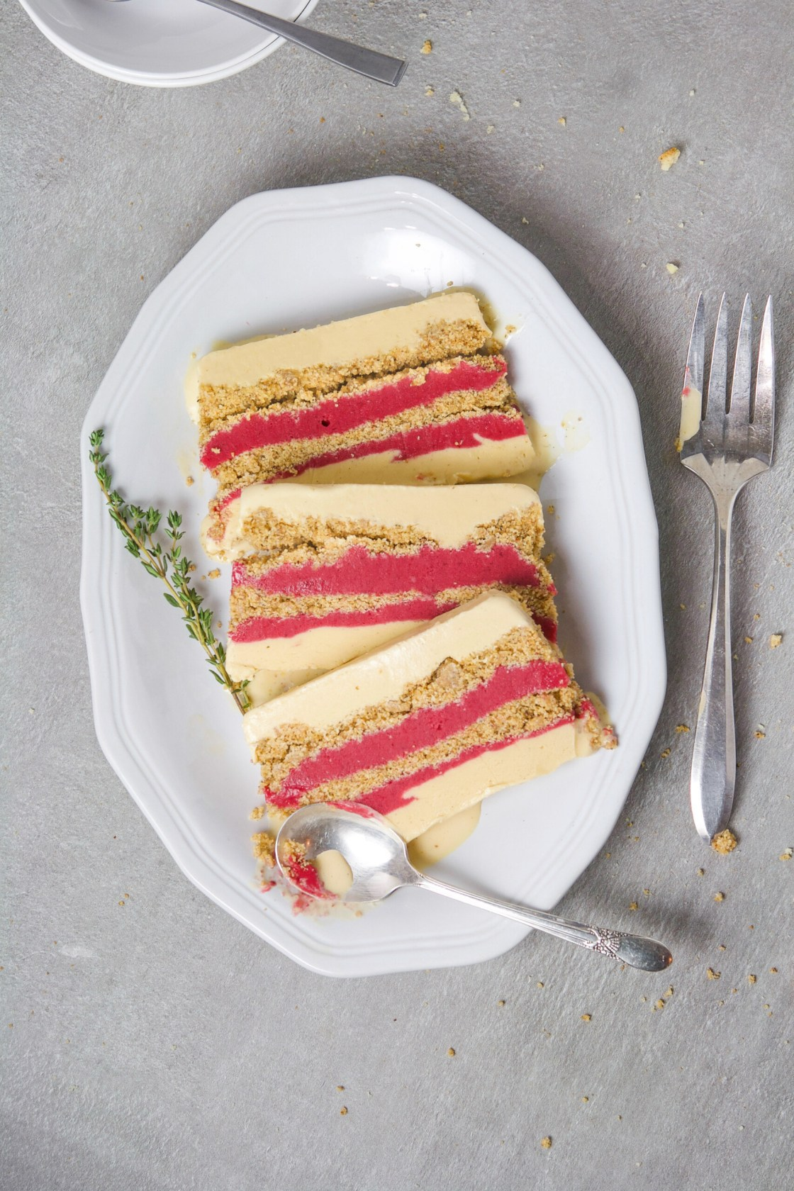 A wonderfully festive, and easy-to-make dessert, this layered ice cream cake featuring creamy goat milk ice cream, naturally sweetened cranberry curd, and a nutty biscotti layer, is most definitely one for the books. | from Lauren Grant of Zestful Kitchen