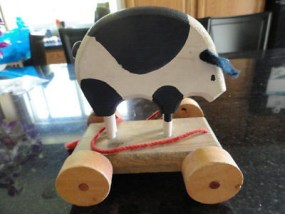 Vintage Folk Art Cow Pull Wood & Paint Toy Handmade Signed by Artist 1983